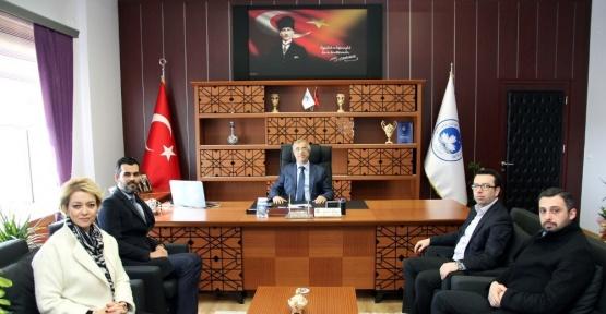MHP'den yeni rektöre ziyaret