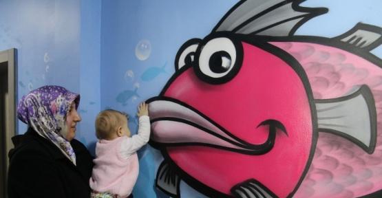 (Özel Haber) Kanserli minikler için hastane duvarlarına graffiti yaptılar